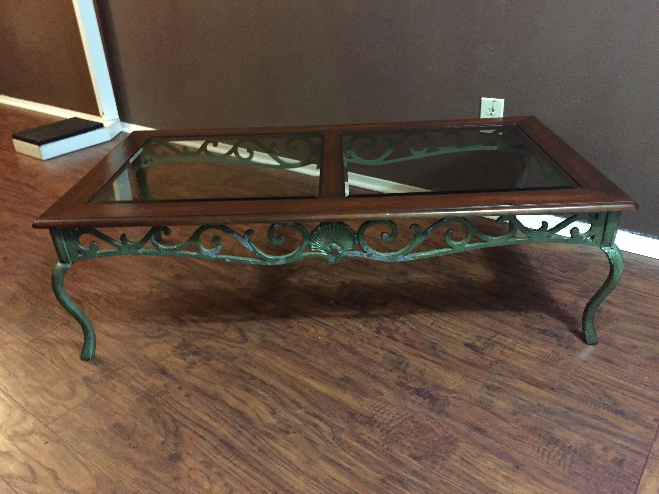 Wood and beveled glass top coffee table Metal base for sale in