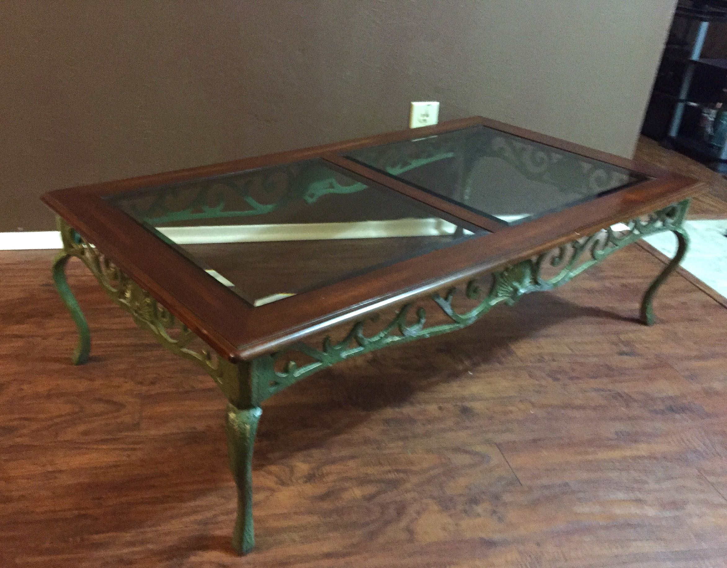 wood and beveled glass top coffee table. metal base for sale in